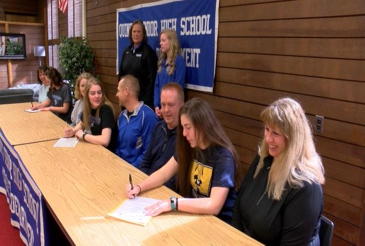 QHS volleyball players Kayla Mast, Nicole Stock, and Ali Spohr signed their national letters of intent Friday.