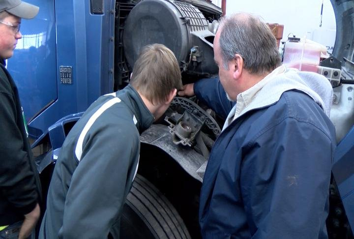 Students getting an up close view of a truck.