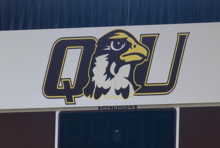 Quincy University logo.