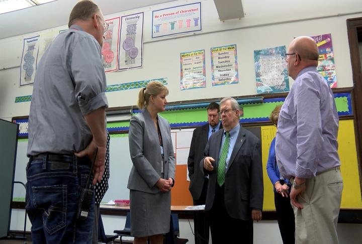 State Representatives tour the middle school.