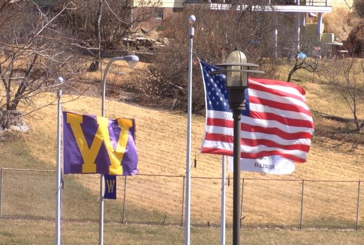 WIU and American flags on campus.