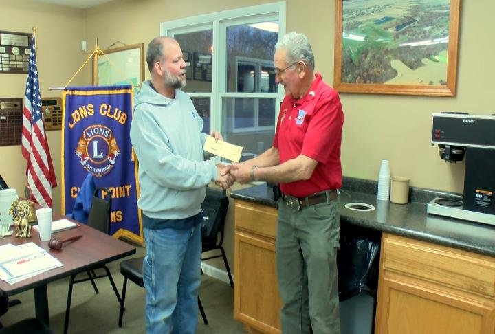 A $500 donation from the Camp Point Lion's Club to the Great River Honor Flight