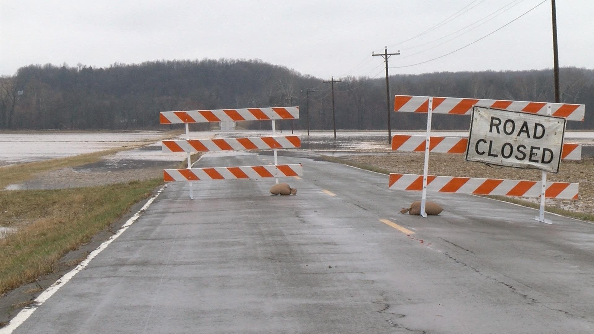MoDOT crews put up signs to close Route F.