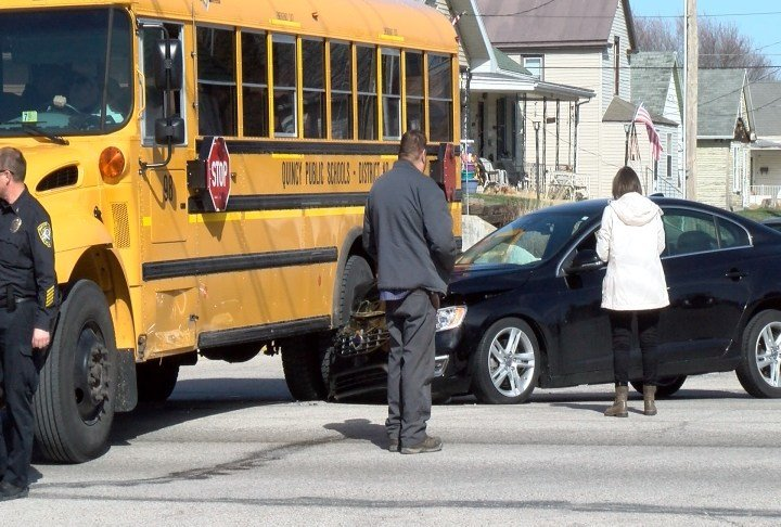 Car and school bus collide