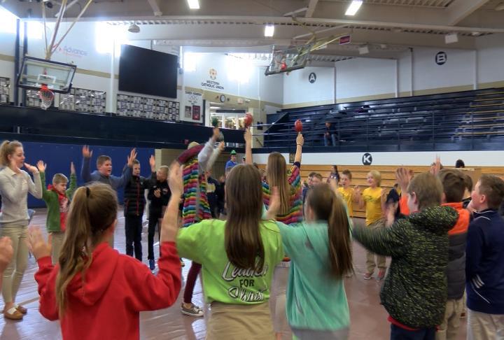 QND students teaching different cultural dances.