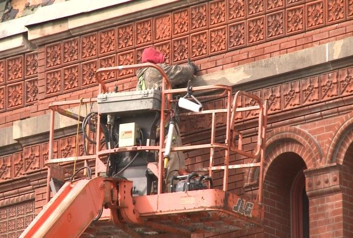 Crews tuck-pointing the brick back in October.