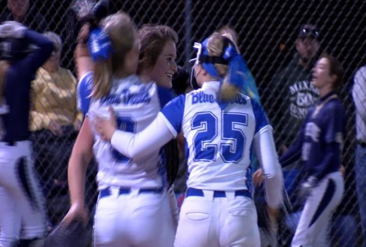 QHS celebrates following its 4-3 victory over QND on the softball diamond.