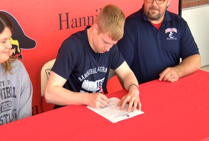 Hannibal's Kaleb Greening pledges Hannibal-LaGrange wrestling.