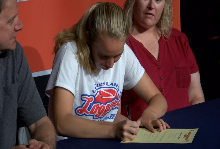Katie Rhodes was one of 12 Illini West student athletes who signed on the dotted line Wednesday.