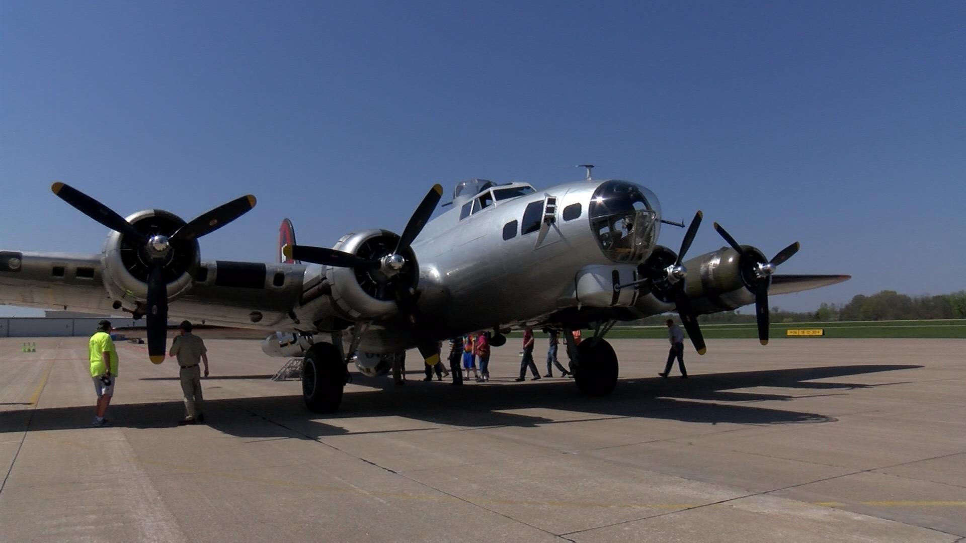 "The B-17 ""Aluminum Overcast"" sits on the tarmac at Southeast Iowa Regional Airport in Burlington."