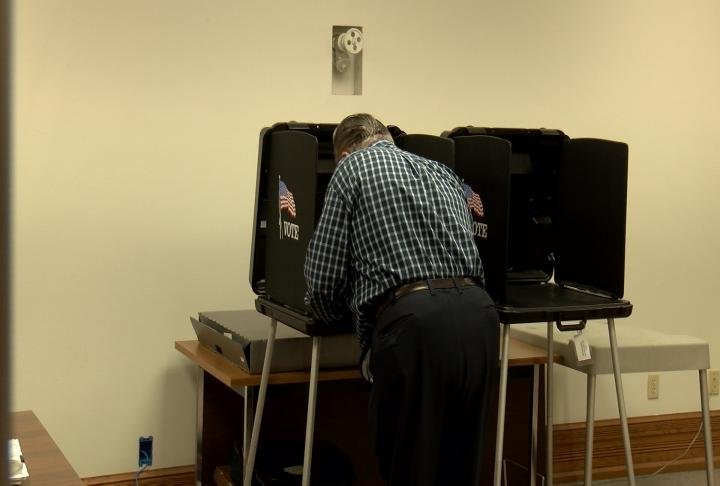 Rep. Kearns voting in the booth.