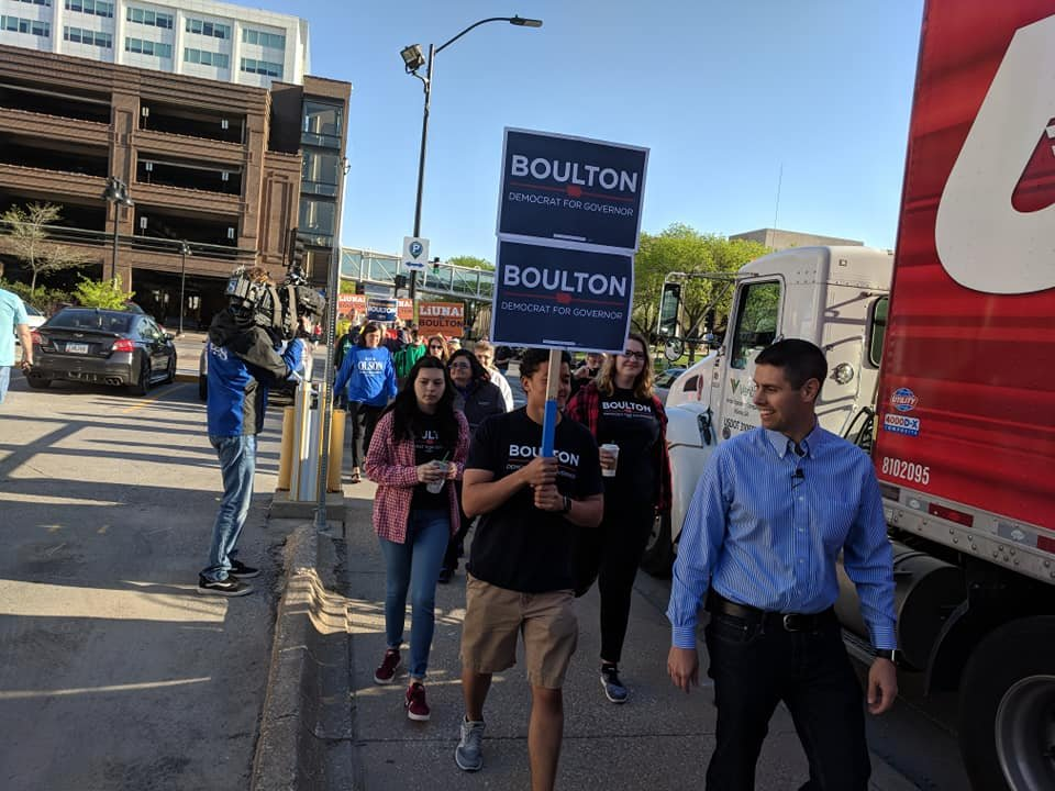 Boulton leading supporters to the polls.