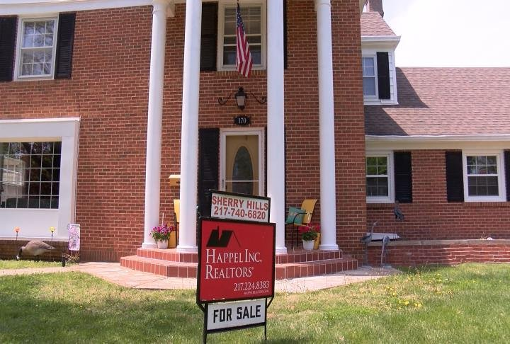 A for sale sign outside a home in Quincy.