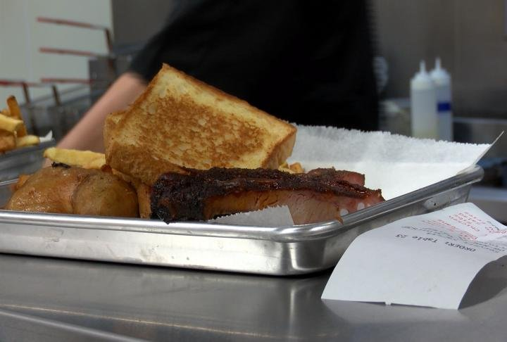 Young says when you walk in you'll immediately smell the barbeque, which is cooking on two large smokers in the back.