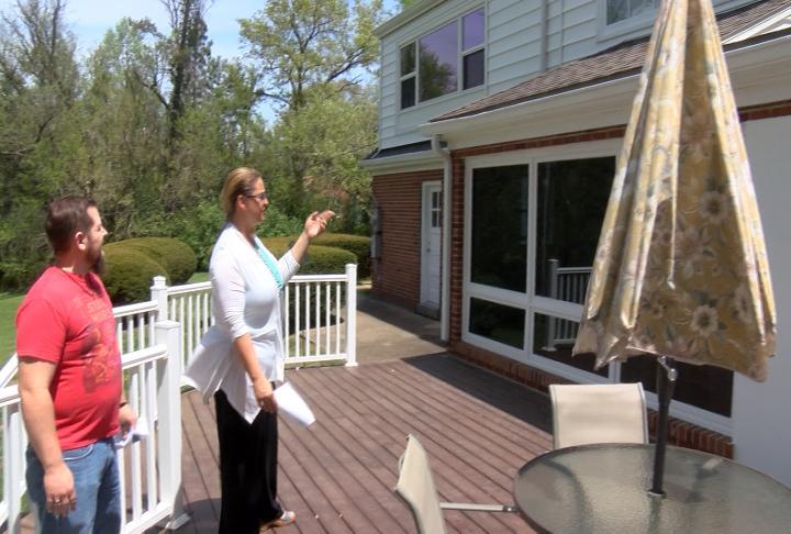 Realtor Jackie Weisenburger (right) showing Ryan Freeman (left) a home.