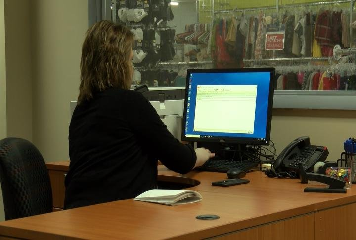 Director Remick going through emails in the career center.