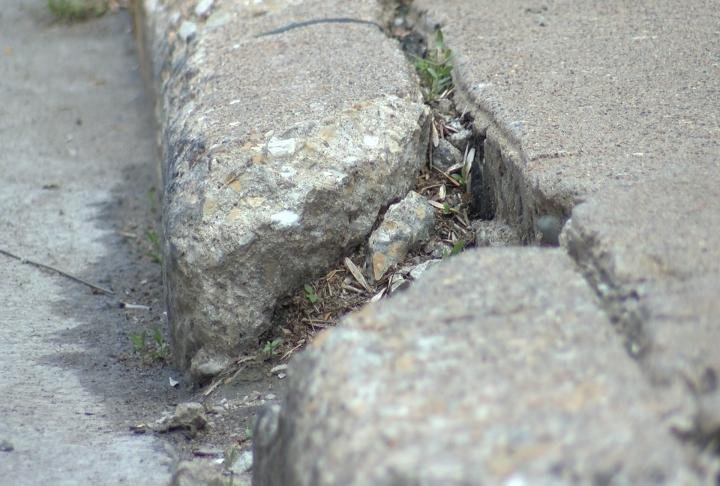 Cracks are seen along the street from 6th to 10th street.