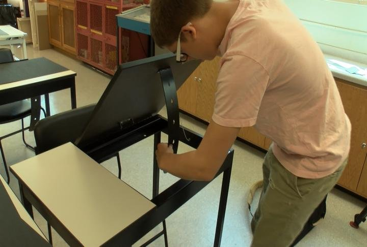 Students showing off the new desks.
