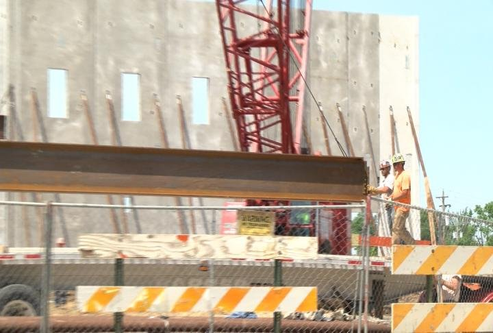 Metal beams were also put up to support the walls.
