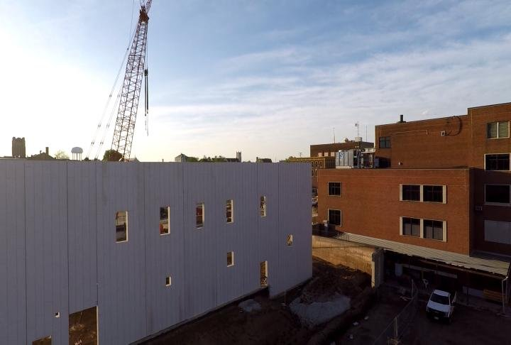 WGEM News Drone captured crews standing one of the walls up.