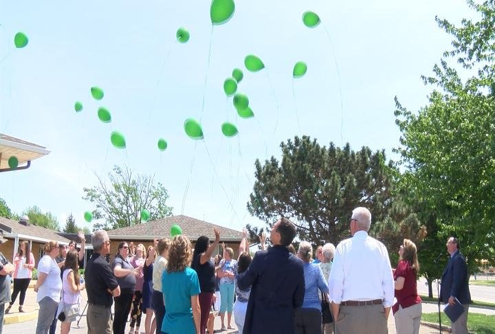 People gathered to release balloons to the month
