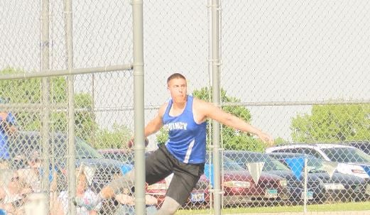 Quincy's Jordan Johnson set a new WB6 meet record en route to winning the conference title in the discus.