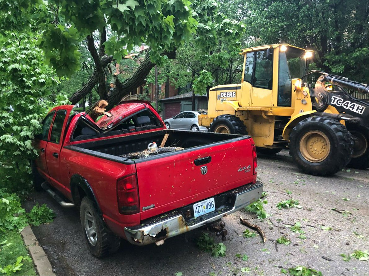This Dodge truck is one of two vehicles damaged when a tree fell on it on Bird Street in Hannibal. It happened during severe weather Monday night.