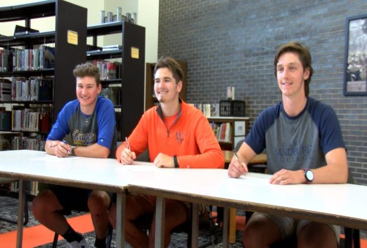 Macomb's Joe Musick, Brandon Bickers, and Jacob Burg signed their national letters of intent Friday.