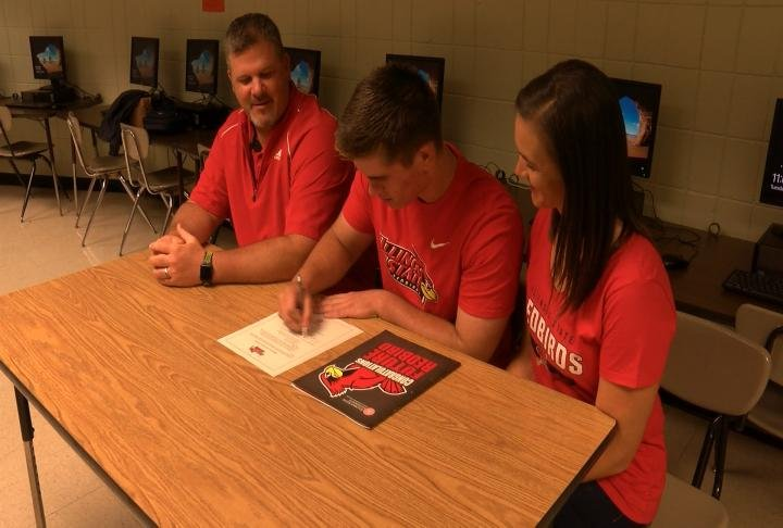 Macomb's Ben Gentry signs his letter of intent to cheer at Illinois State.