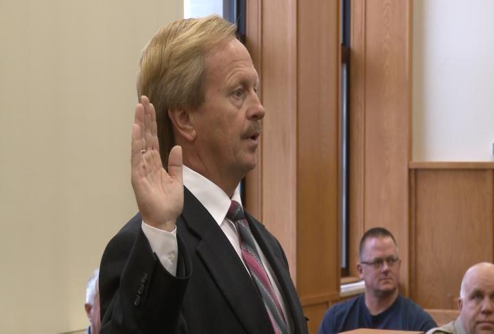 Jim Keller being sworn in.