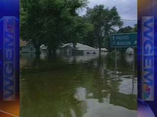 High water floods the streets near small towns in Illinois.