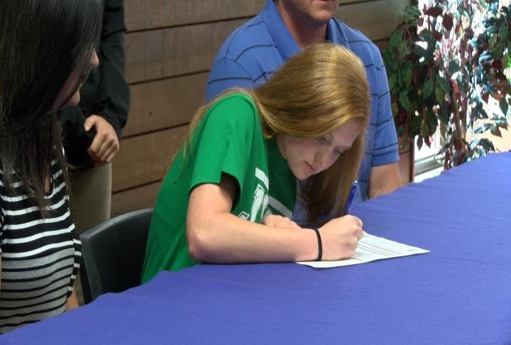 Quincy's Abbie Reis put pen to paper Thursday and pledged John Wood women's soccer.