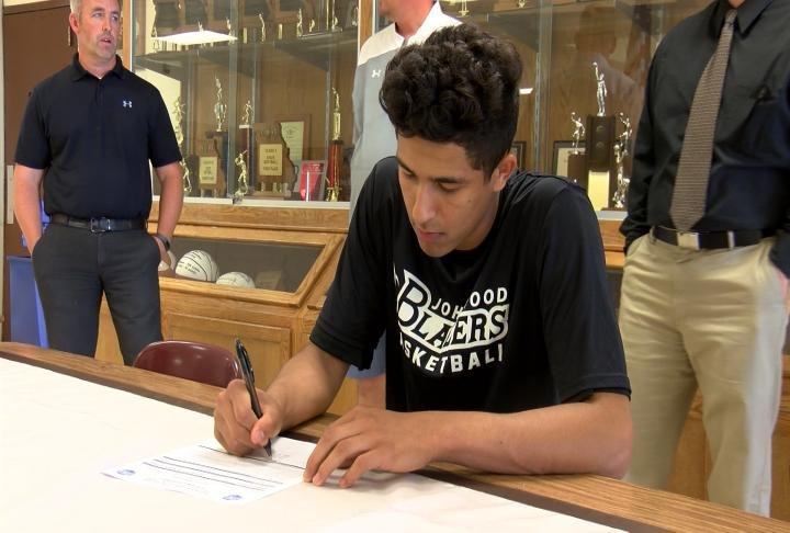 Highland's Keetan Johnston became the latest area standout to pledge John Wood basketball on Tuesday.