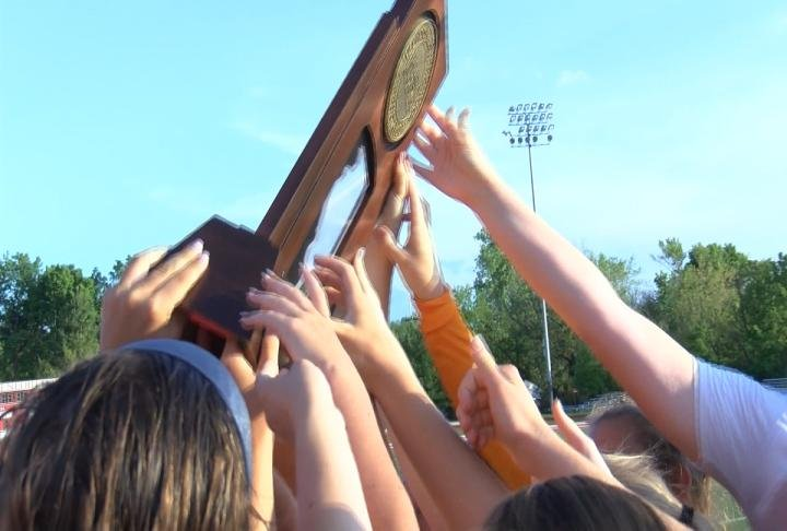 QND hoists the Class 1A state championship trophy for the second consecutive season.