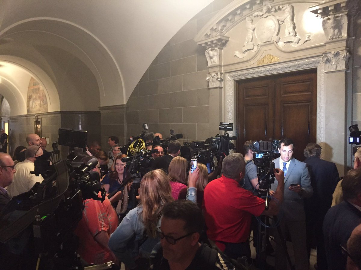 Media heading into the governor's office.