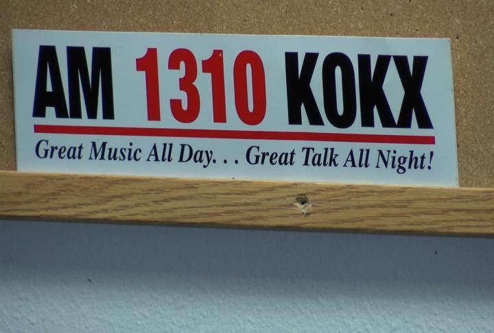 Radio station sign hanging up.