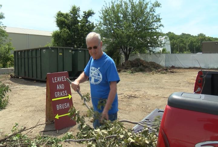 John Schafer dumping yard waste at the lot at 9th and Warren Barrett Drive