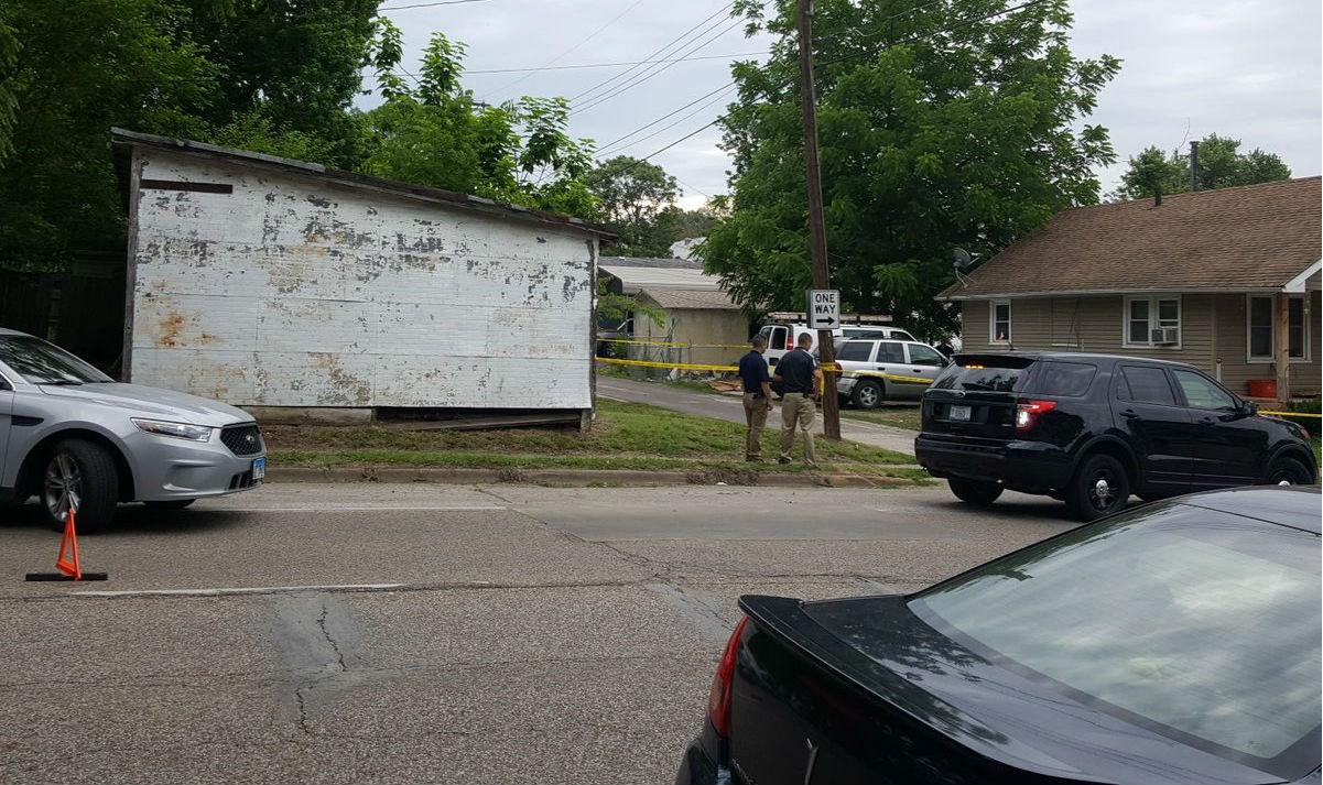 Detectives stand outside house Thursday morning