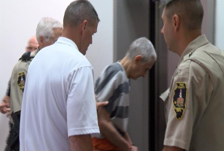Sampley being escorted out of court