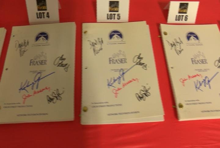 Signed script books by John Mahoney for the auction.