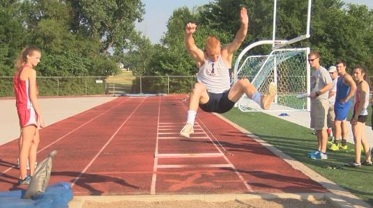Illini West's Connor Artman set a new meet record, personal best, and top mark in the state in the long jump.