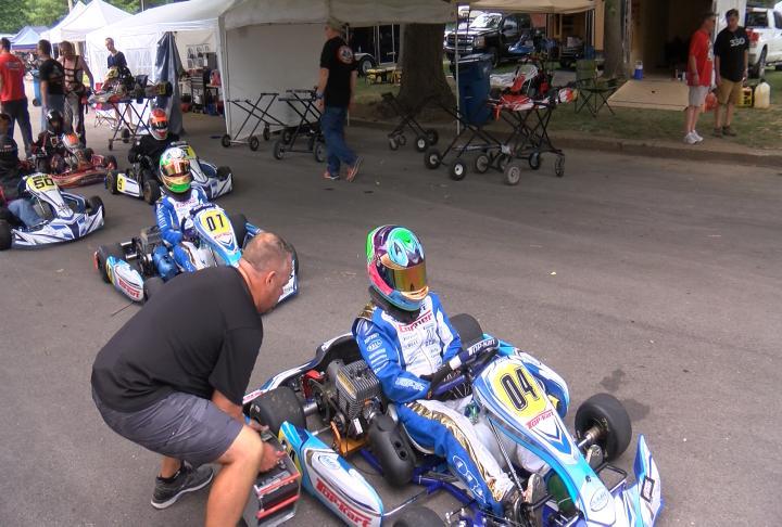 Bryan Venburg helping prepare his children prior to the practice race.
