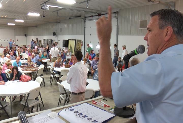 Dan Sullivan auctions off items.