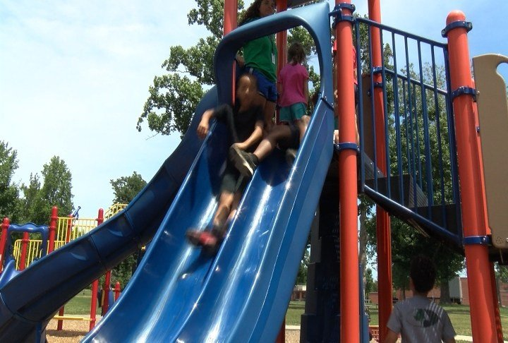 Kids on slide In Madison Park