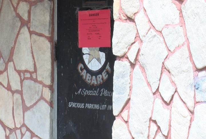 "City officials say red ""danger"" signs were put up on the doors of 122 and 124 North Fifth Street on Monday."