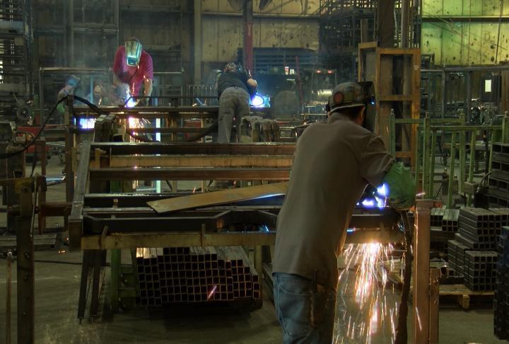 Crews welding the racks.