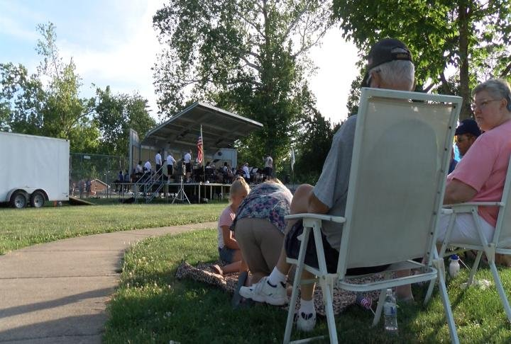 Citizens listen to the Quincy Park Band at Madison Park where the Exchange Club celebrated Flag Day one day early.