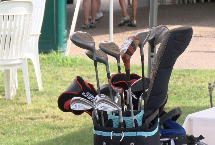The golf outing helped raise money for children with muscular dystrophy to go to summer camp.