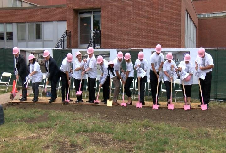McDonough District Hospital employees break ground on a new women's center.