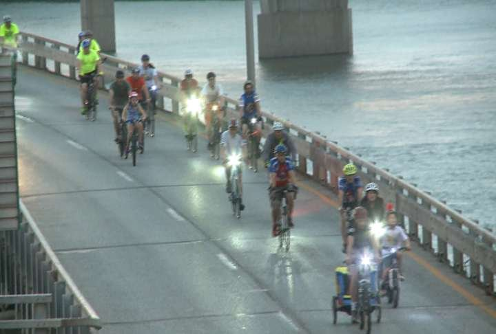 Riders cross the Memorial Bridge into Quincy during the 2017 Moonlight Ride For Hunger.